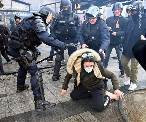 عکس/ حمله پلیس فرانسه به یک زن - 3