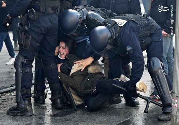 عکس/ حمله پلیس فرانسه به یک زن - 0