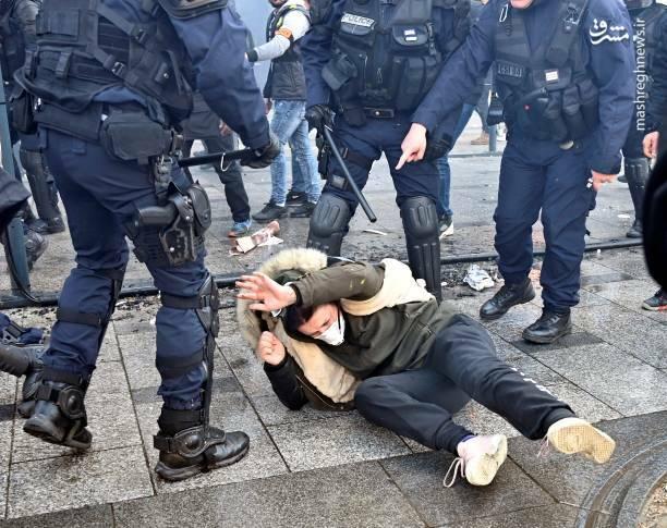 عکس/ حمله پلیس فرانسه به یک زن - 6